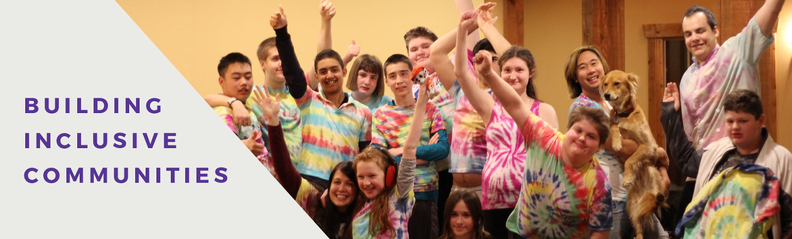 a group of youth cheer in brightly coloured t-shirts. the caption reads building inclusive community.